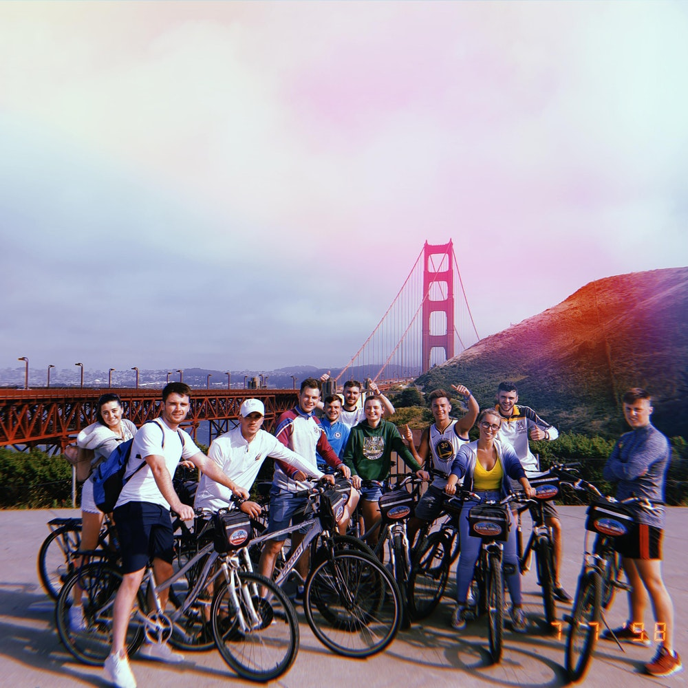 friends on bikes at golden gate bridge